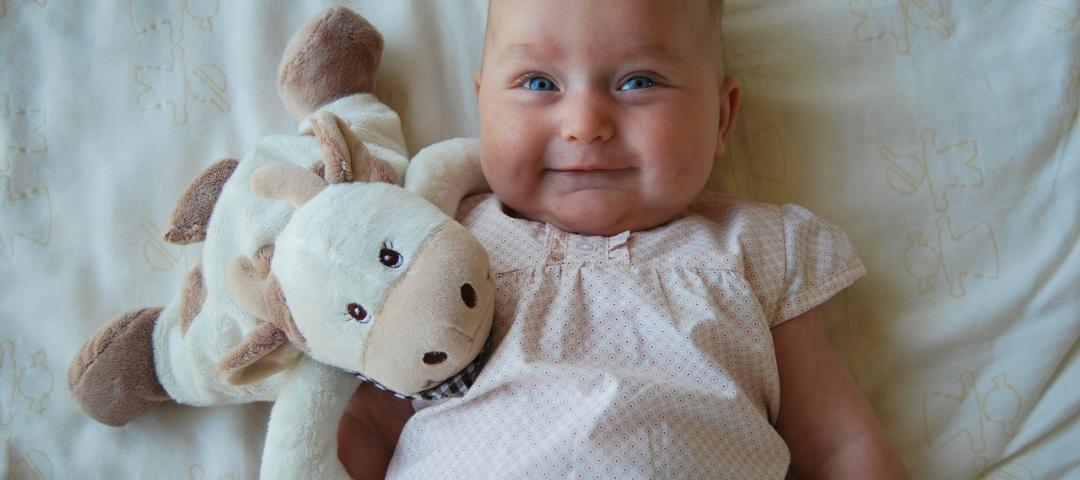 Baby with plush animal